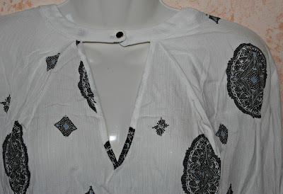 http://www.shein.com/White-Cut-Out-Front-Tribal-Print-Blouse-p-255767-cat-1733.html?utm_source=paroleopereomissioni.blogspot.it&utm_medium=blogger&url_from=paroleopereomissioni