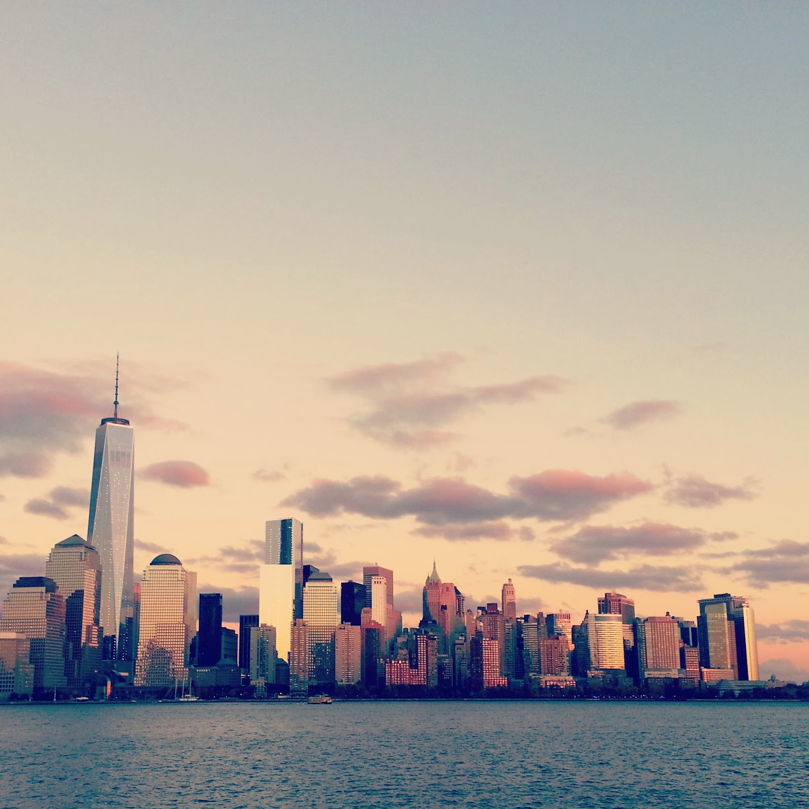 NYC/Manhattan from across the Hudson River  |  The rosy glow of an autumn dusk  |  http://afeatherynest.blogspot.com