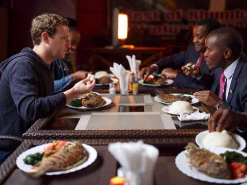 Mark Zuckerberg eats with Kenyan Cabinet Secretary of the Ministry of Information, Joe Muhceru, in Nairobi.