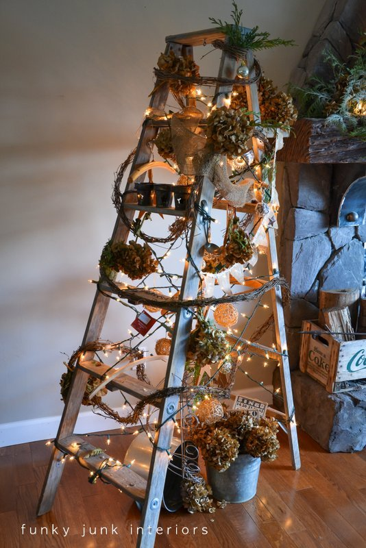 A treeless ladder Christmas tree, decorated with twig garland and hydrangeas, by Funky Junk Interiors