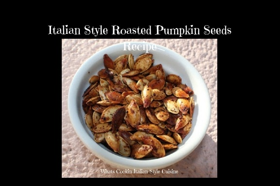 These are Italian seasoned roasted pumpkin seeds on a cookie sheet being backed with a carved sugar pumpkin roasted from Halloween.  The seeds were raw and then roasted with Italian seasoning. This is how to roast pumpkin seeds and make them from scratch by using a sugar pie pumpkin after carving from Halloween. These pumpkin seeds are in a white round bowl and have a crispy outside shell and ready to snack on.