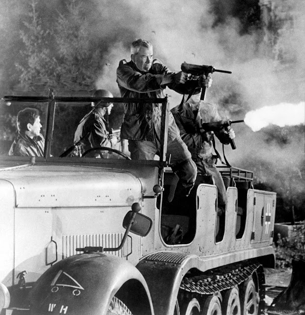 Lee Marvin firing from a German half-track in The Dirty Dozen movieloversreviews.filminspector.com