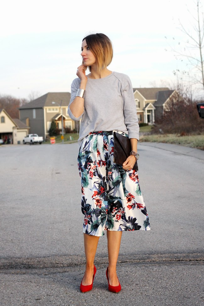 Floral skirt, gray sweater, red heels