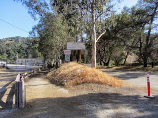 Toyon Trail junction with Mt. Hollywood Drive and an entrance to a sanitation facility, Griffith Park