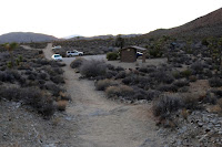 Heading west on Desert Queen Mine Trail approaching the Pine City Backcountry Board parking area and trailhead, Joshua Tree National Park