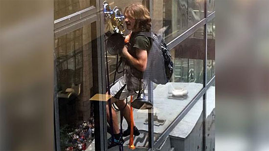 Steve climbing Trump Tower