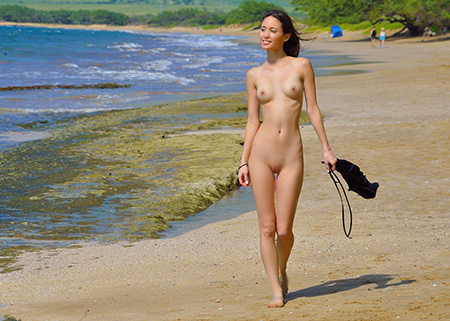 Girl strips naked on beach