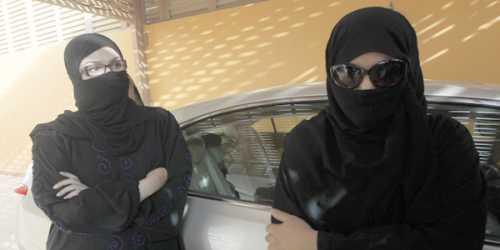 female drivers in saudi arabia, wearing black niqab and chador
