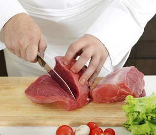 Cutting raw meat