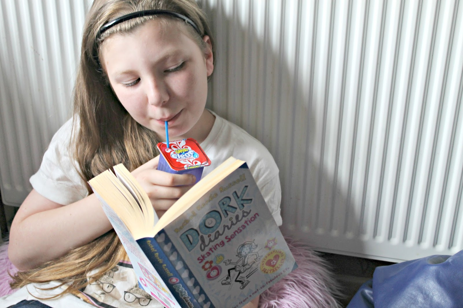 Minxy reading a favourite book with a Calypso drink