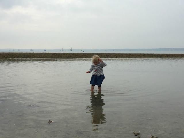 Tin Box Tot paddling in the sea