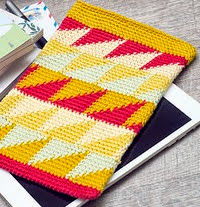 http://www.ravelry.com/patterns/library/ipad-mini-tapestry-crochet-sleeve