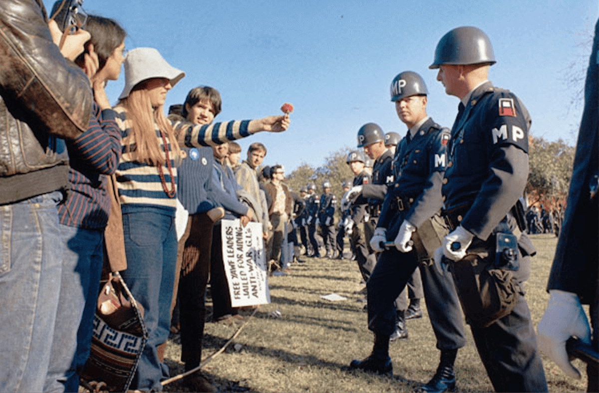 Be the Flower in the Gun: The Story Behind the Historic Photograph