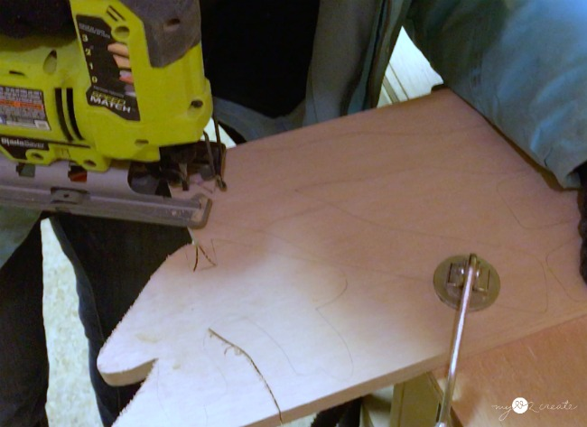 using a jigsaw to cut out wooden reindeer