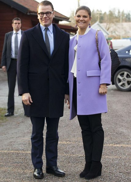 Crown Princess Victoria and Prince Daniel visited Fagersta Municipality. Princess wore a wool coat. diamond earrings