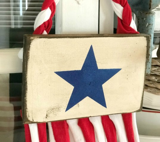 Stenciled star on a recycled American Flag made from t-shirts