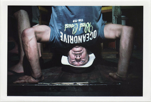 dirty photos - upon - flash street photo of man being upside down in night club in matala