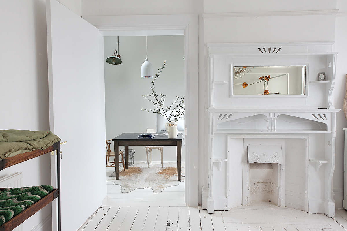 white painted floors, fireplace, bohemian interior