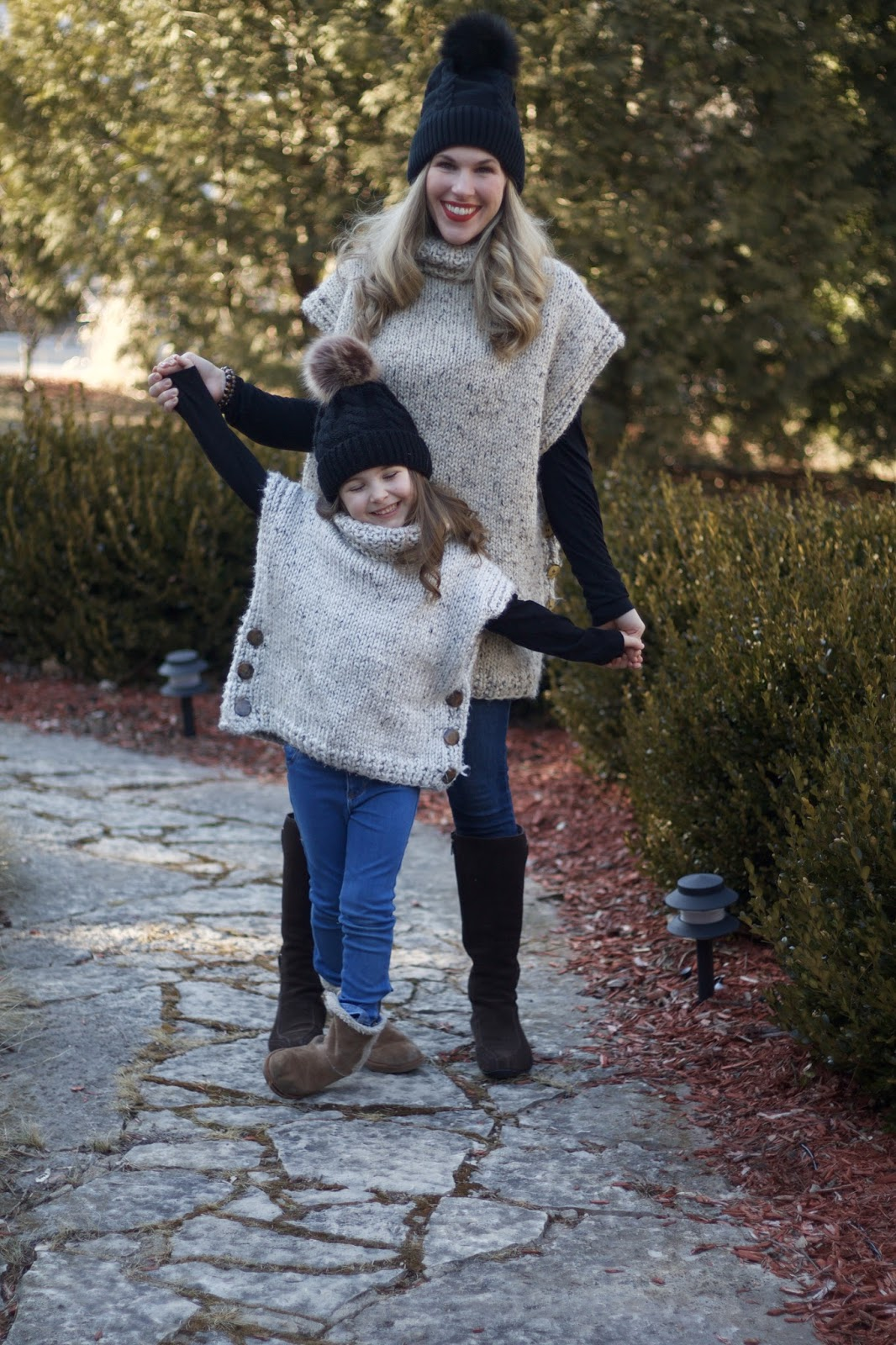 handmade poncho, Rockstar jeans, brown suede riding boots, black fur pom pom hat, mommy & me, mommy & me poncho