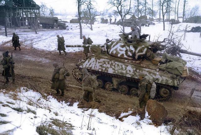 Snow-camouflaged M4A3 76w Sherman tank color photos of World War II worldwartwo.filminspector.com