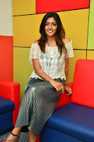 Eesha in a cute deep neck top and Skirt at at Big FM 027.JPG