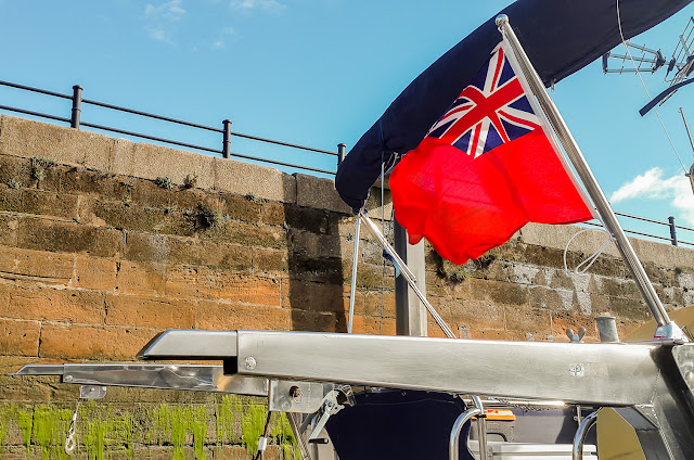 Photo of the red ensign flying from Ravensdale's new flagpole