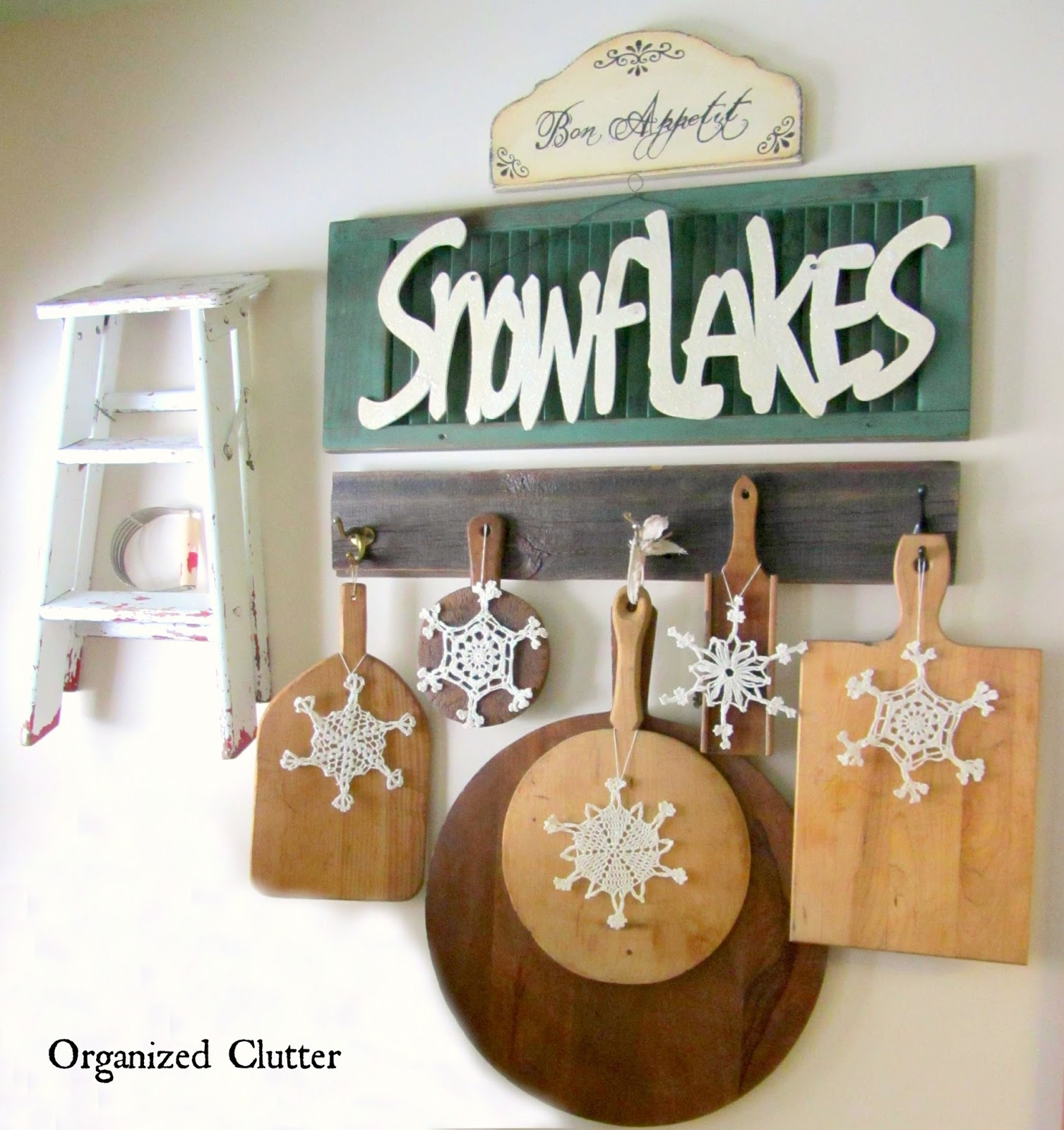 Adding Christmas/Winter Touches to Wall Displays www.organizedclutterqueen.blogspot.com