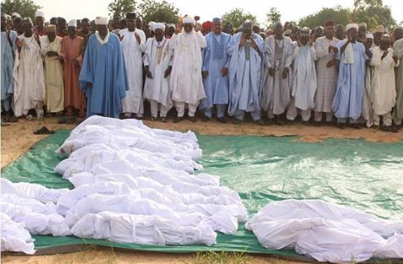 Photos From Mass Burial Of 21 Victims Who Died During Boat Mishap