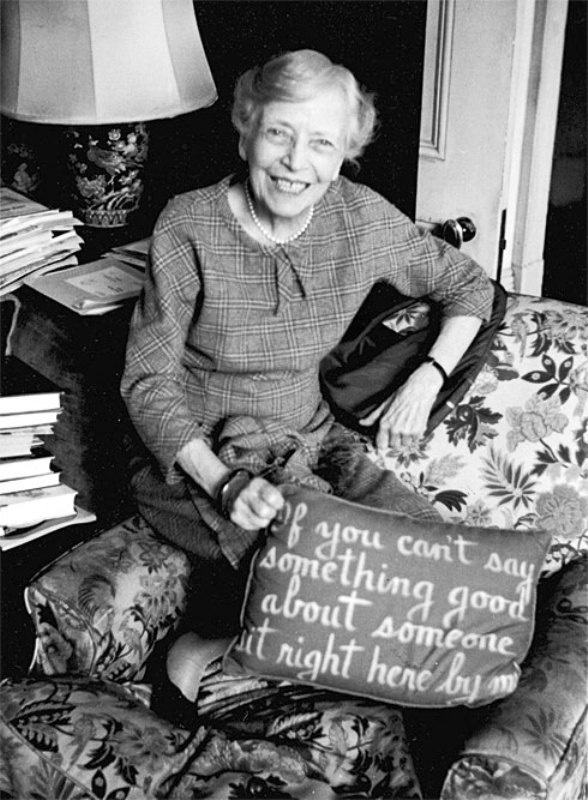 "Alice Roosevelt Longworth holds embroidered pillow ""If you can't say anything good about someone sit right here by me"""