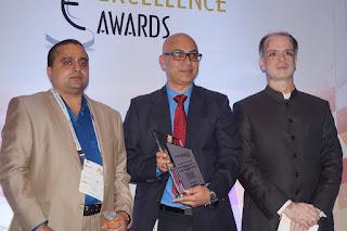 Mr. Chetan Verma, Vice President - Strategy, NBHC receiving the award