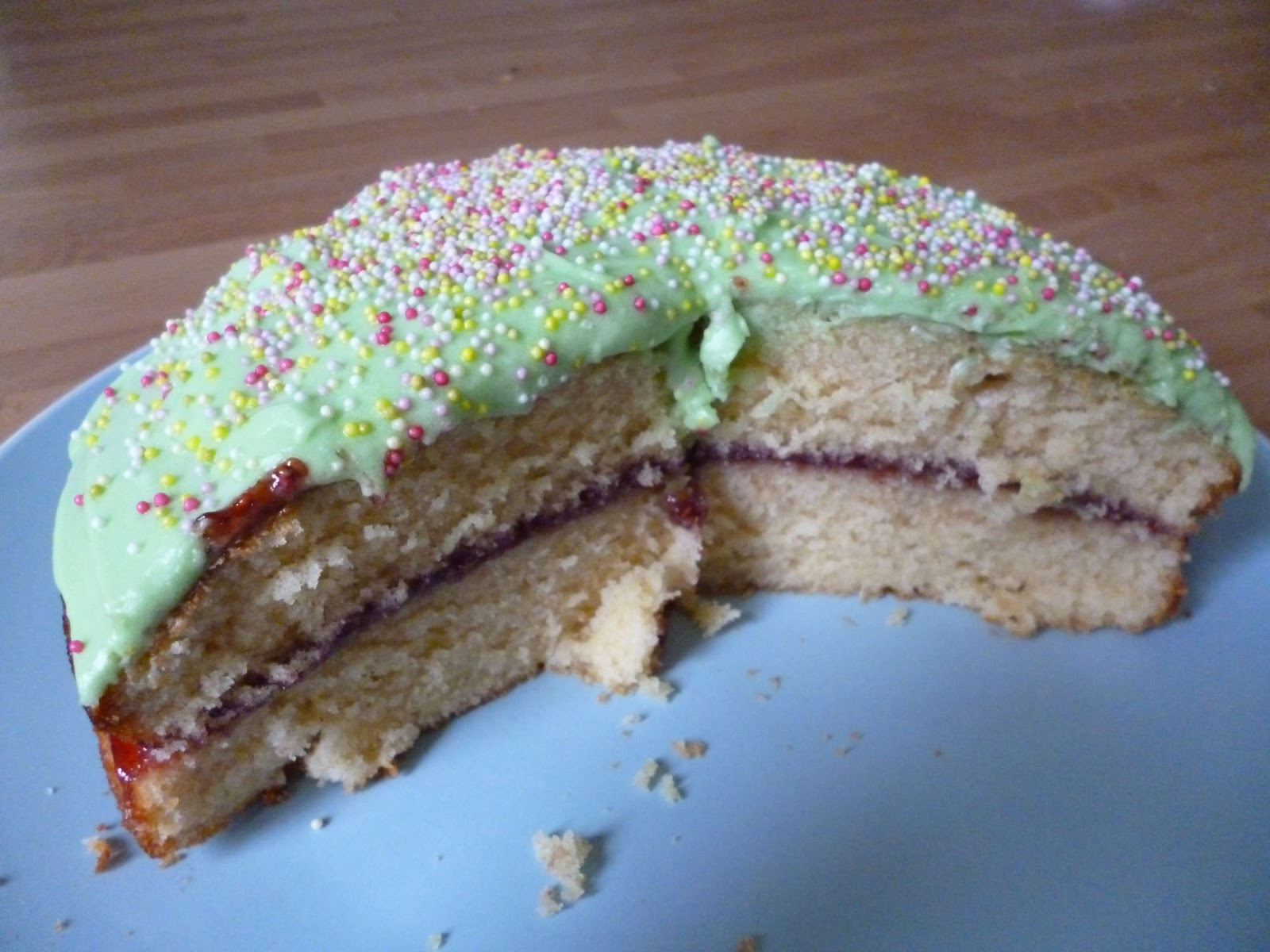 cake sliced crumbs green frosting icing