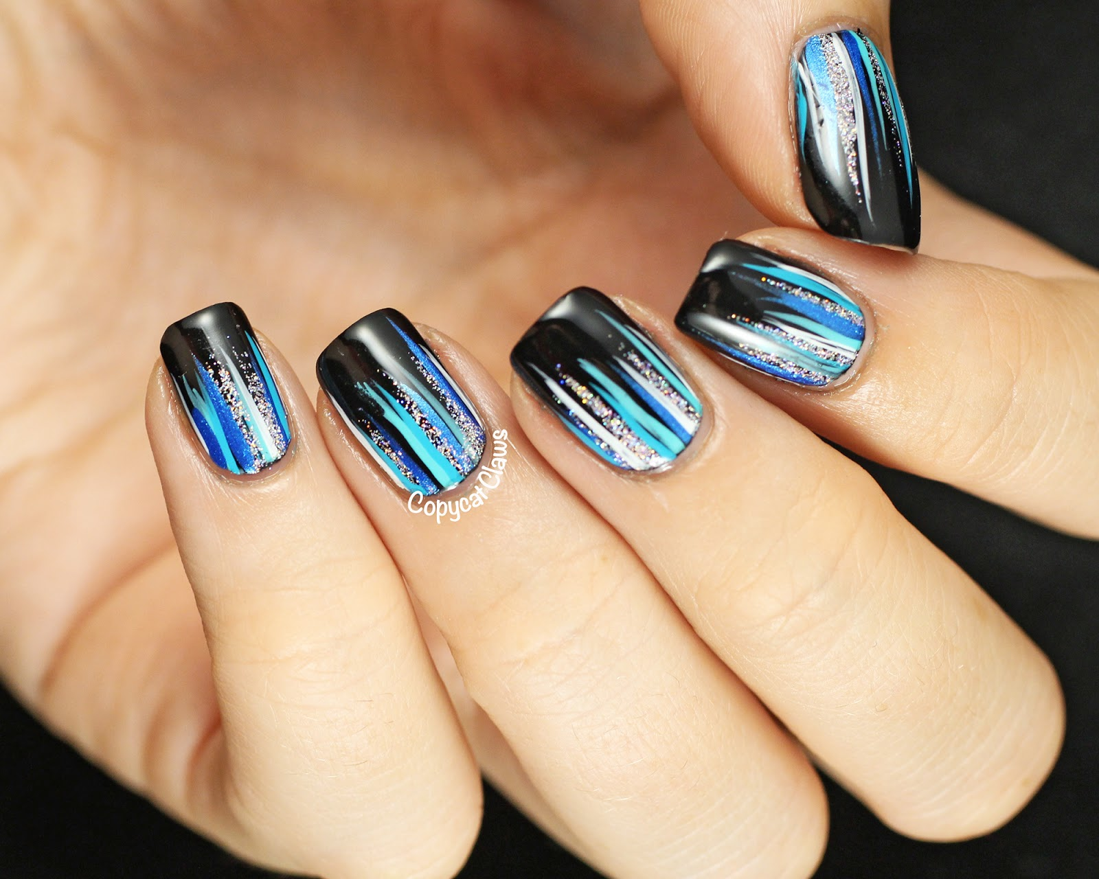 Copycat claws waterfall nail art i started with my favourite black a england camelot and then added various blue white and silver stripes using some stripe rite colours prinsesfo Choice Image