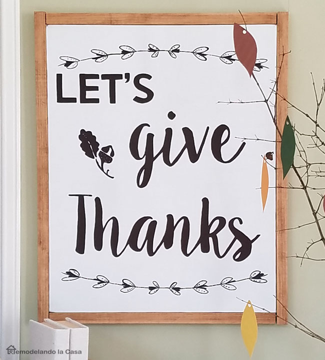Rustic white canvas with black letters saying Let's Give Thanks