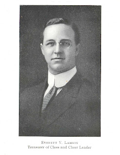 "A black and white photograph of a man in a suit and glasses. The portrait is captioned ""Everett V. Lansom Treasurer of Class and Cheer Leader."""