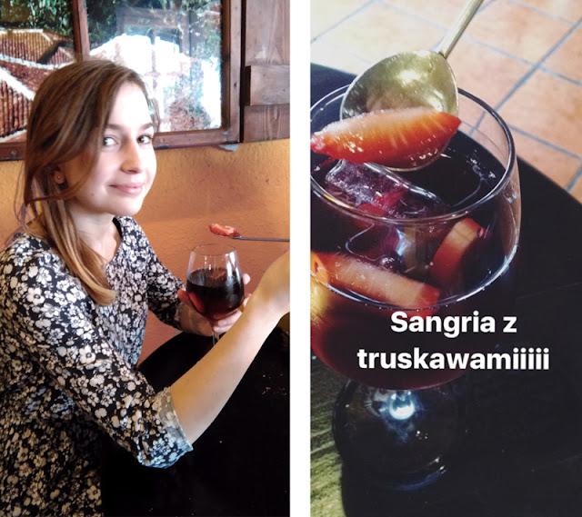 dziewczyna pijąca sangrię z truskawkami i wyjadająca owoce łyżeczką