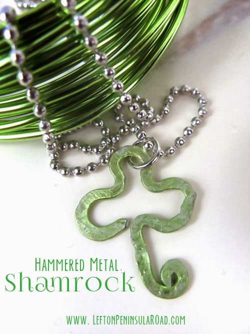 Hammered green wire shaped into a shamrock for St. Patrick's Day.