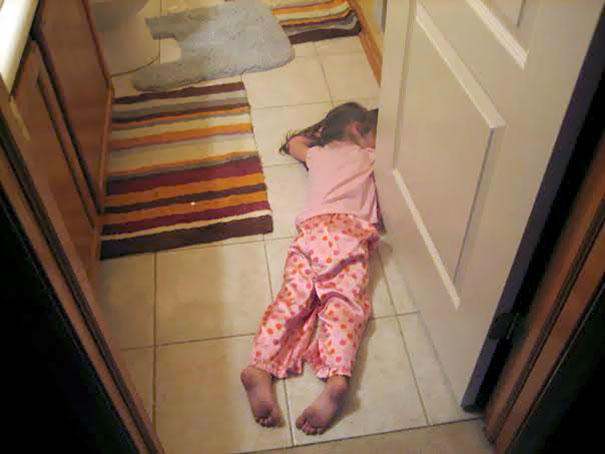 15+ Hilarious Pics That Prove Kids Can Sleep Anywhere - Napping On The Bathroom Floor