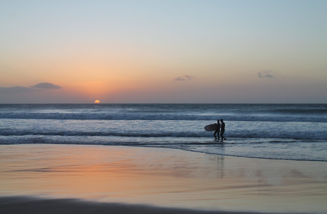 Surfers during the Sunset in Fuerteventura