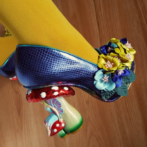 close up of fairy toadstool heeled shoes being worn