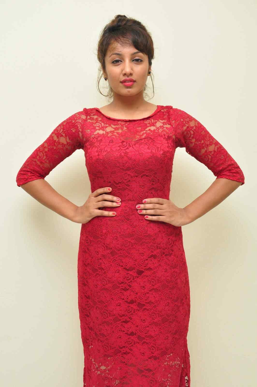 Telugu Actress Tejaswi Stills in Maroon Dress