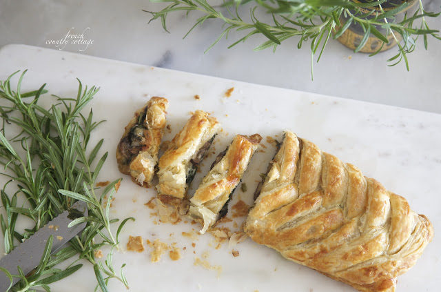 Spinach mushroom pastry braid on marble board