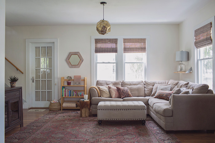 living room reveal with gray sofa and pink kilim rug