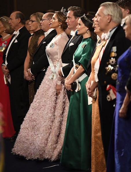 Queen Silvia, Crown Princess Victoria, Prince Daniel, Prince Carl Philip, Princess Sofia, Princess Madeleine and Christopher O'Neill attended 2016 Nobel award ceremony at Stockholm Concert Hall