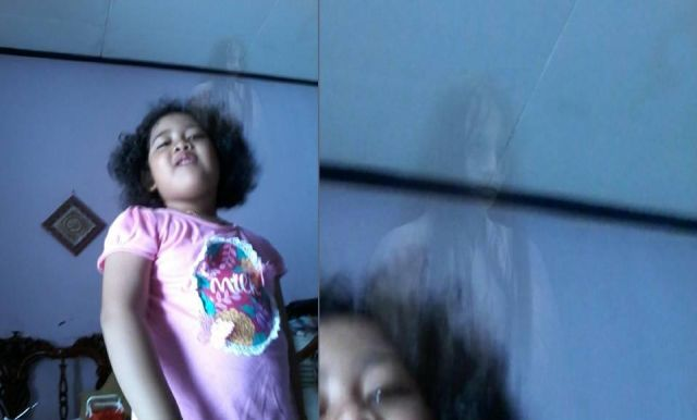 Haunting Image Shows Ghost Behind 5-year-old Indonesian Girl  Haunting%2BImage%2Bshows%2BGhost%2BBehind%2B5-year-old%2BIndonesian%2BGirl