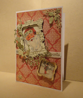 Christmas card with old fashioned Santa image in frame, foliage and bow