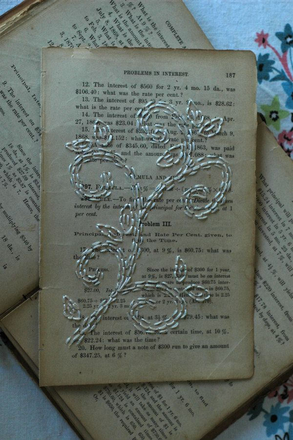 white embroidery on antique book page
