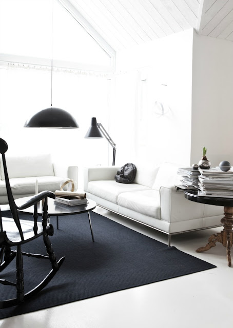 black white living room home house apartment rug dome pendant light rocking chair sofa couch interior design decor furnishings
