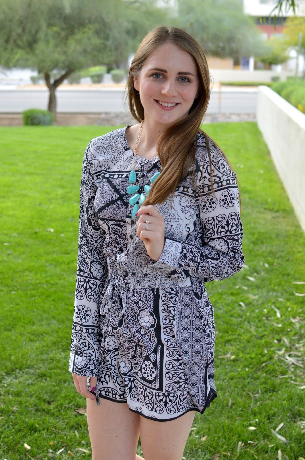 turquoise necklace with black and white romper