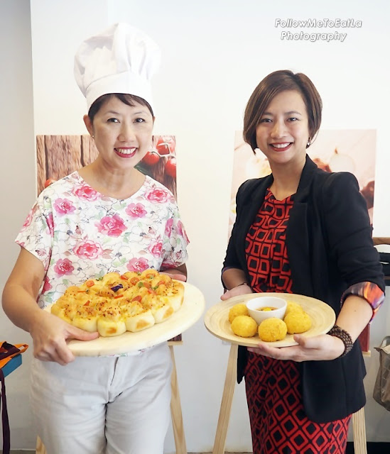 Anytime Is A Good Time For Some Cheesy Pizza! Posing With Ms Linda Tan, Director of Anchor Food Professional