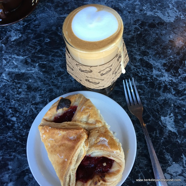 cafe au lait and cherry pastry at Caffe Chiave in Berkeley, California